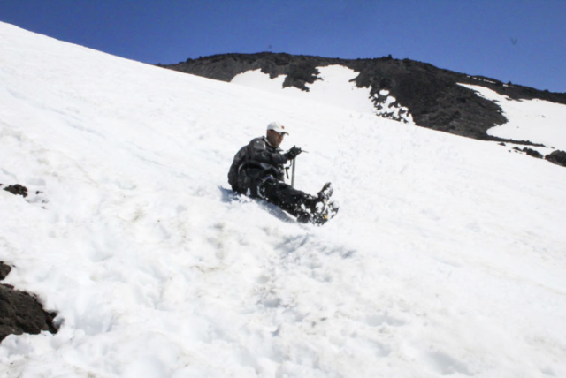 A man glissades down the slopes of Mount St. Helens. Photo by Eric Schwartz
