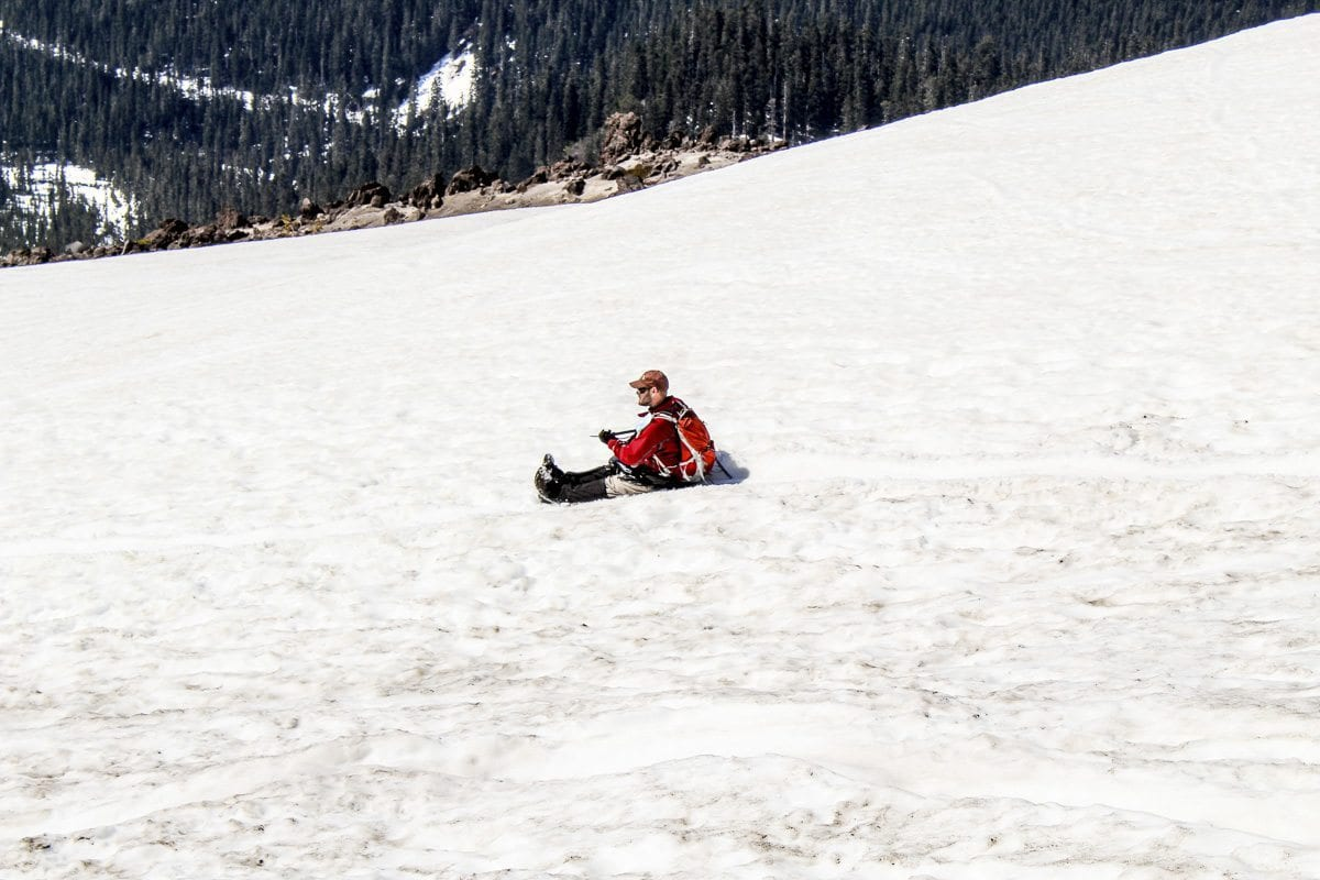 A man glissades down the slopes of Mount St. Helens on Tuesday. Photo by Eric Schwartz