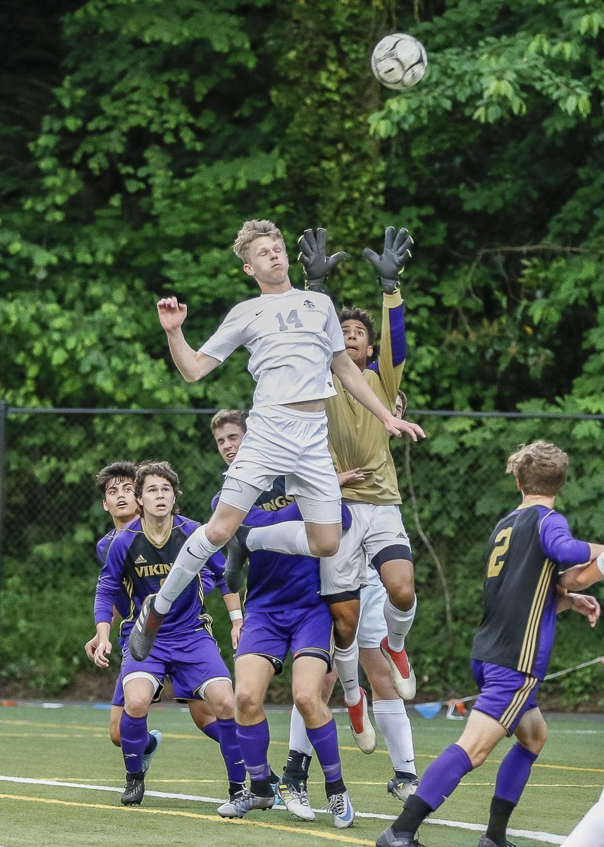 Skyview's Mac Handley goes high in an attempt to get to the ball in the Storm's playoff match against Puyallup. Skyview's season came to an end in a 4-1 decision. Photo by Mike Schultz