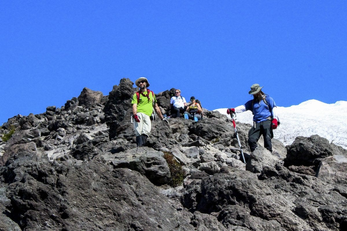 Climbers pause for a break on a rocky outcropping Tuesday on the route to Mount St. Helens. Photo by Eric Schwartz