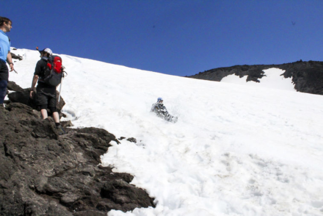 Hikers and those glissading down the slopes of Mount St. Helens cross paths. Photo by Eric Schwartz