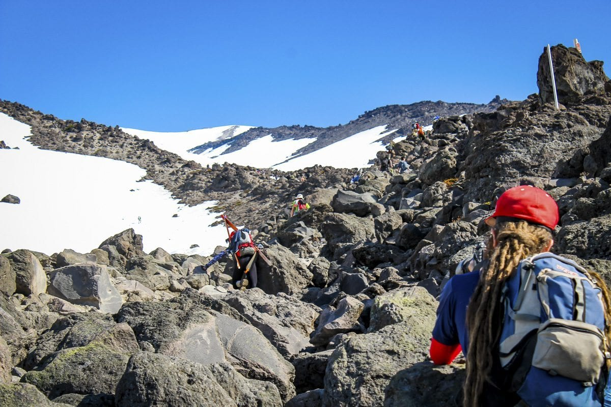 Hikers make their way through a boulder field. Photo by Eric Schwartz