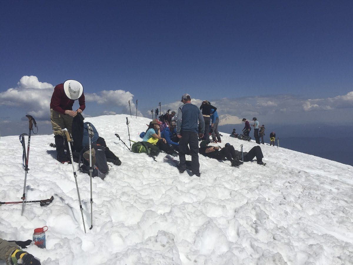Hikers rest at the summit of Mount St. Helens Tuesday. Photo by Eric Schwartz