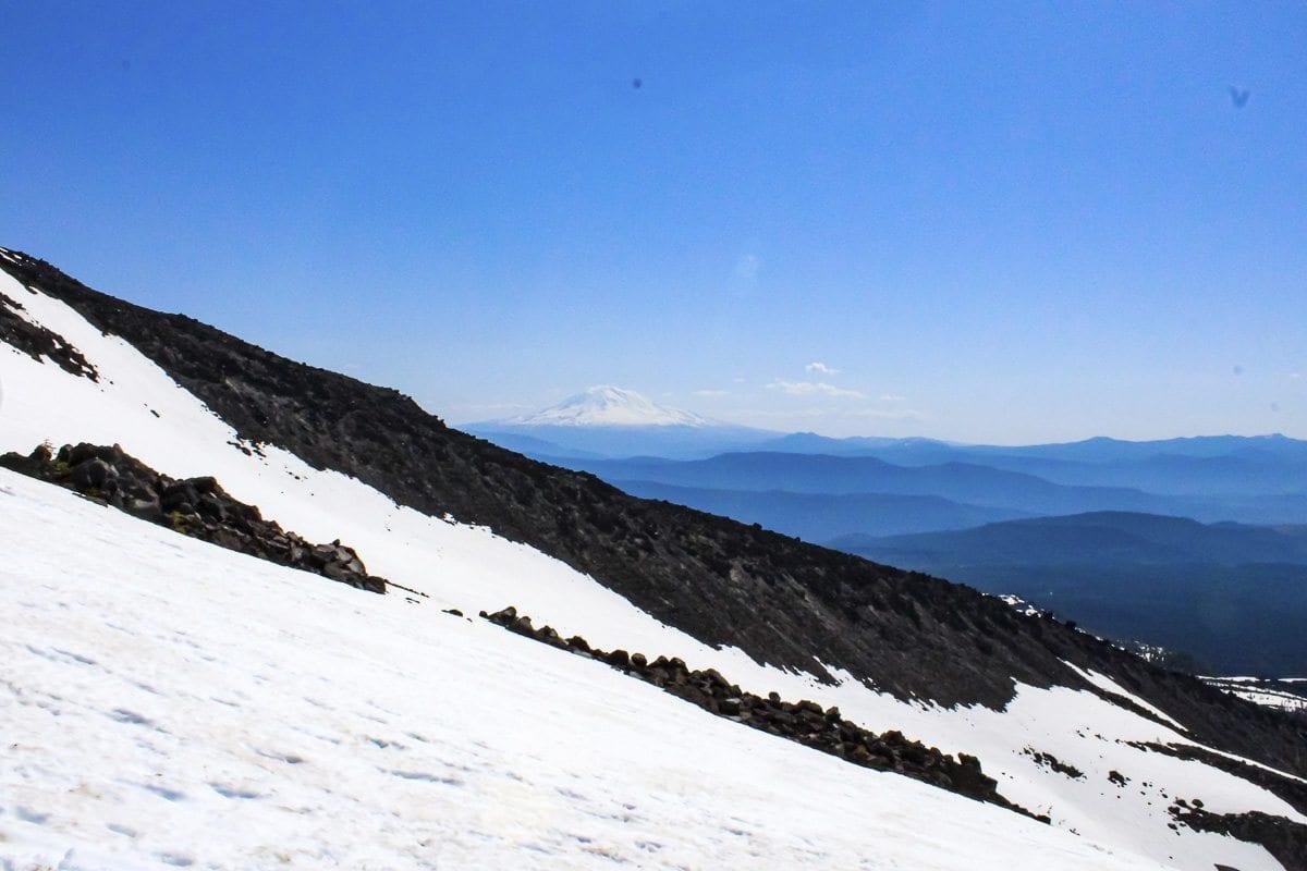Mount Adams is seen beyond a ridge of Mount St. Helens. Photo by Eric Schwartz