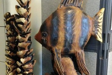 Area artist donates carving to raise critical summer funder for food bank