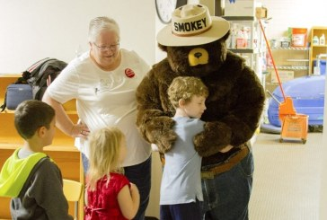 Smokey the Bear teaches Woodland Primary Schools students how to prevent forest fires