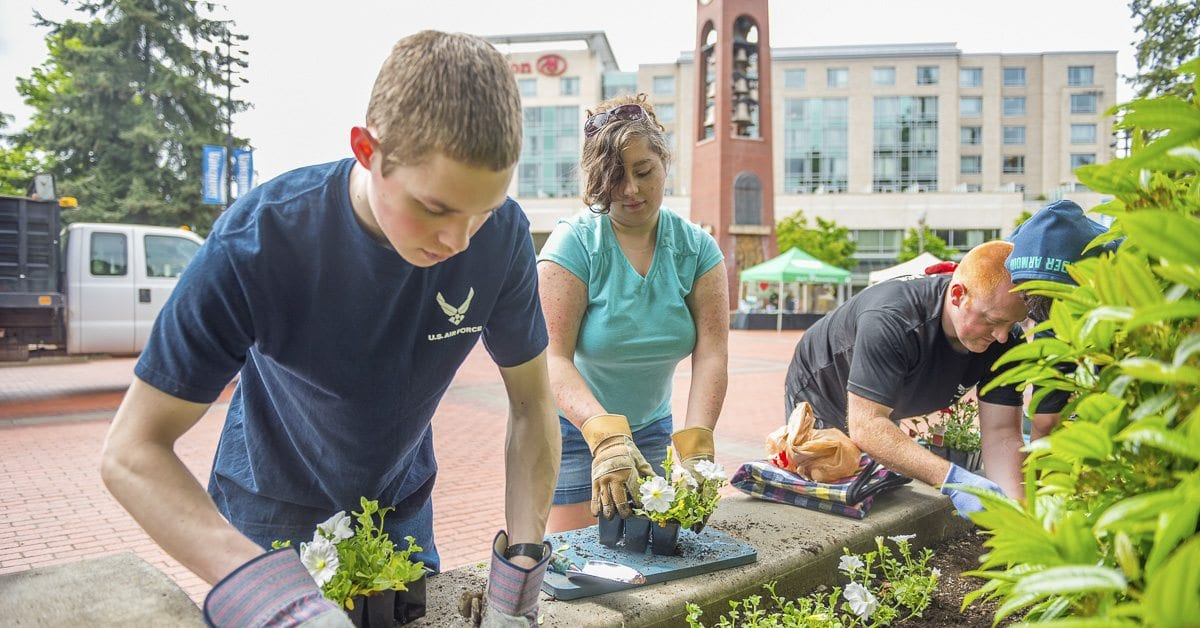 Young volunteers help plant flowers at Esther Short Park. Photo provided by the city of Vancouver