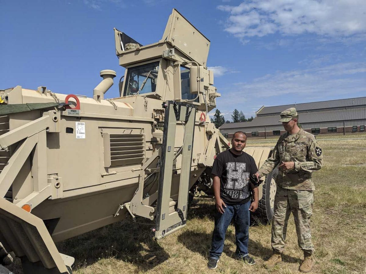 Ranger Cheipot, of Vancouver, received some information on the Husky Engineering Vehicle when he visited Joint Base Lewis-McChord earlier this week. Several future soldiers from Clark County visited the U.S. Army installation. Photo by Capt. Kenneth Wheeler, U.S. Army