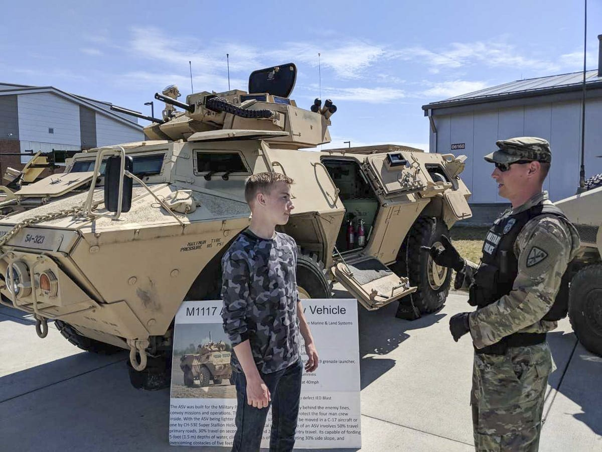 Zachary Davis, of Vancouver, left, gets some information on what life is like working for the military police in the U.S. Army at a recent tour of Joint Base Lewis-McChord. Davis and several other future soldiers visited the installation earlier this week. Photo by Capt. Kenneth Wheeler, U.S. Army