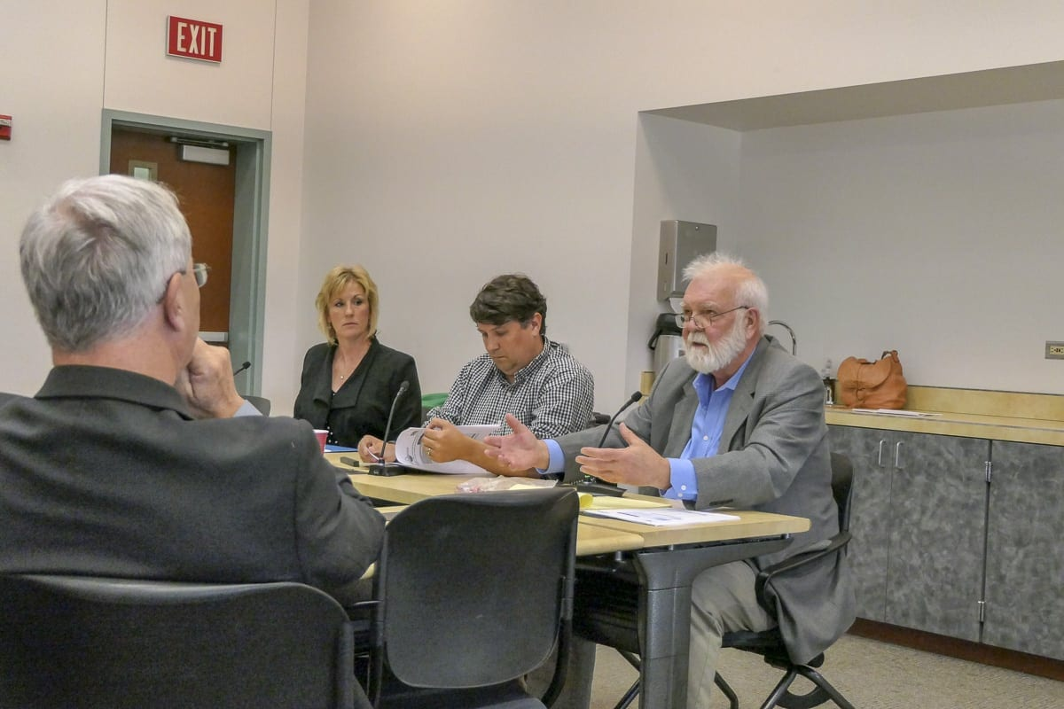 Clark County Council Chair Marc Boldt (far left) listens to Jerry Olson of Olson Engineering (far right), while Darcy Altizer, executive director of SW Washington Contractors Association and Jamie Howsley with the Building Industry Association of Clark County look on. Photo by Chris Brown