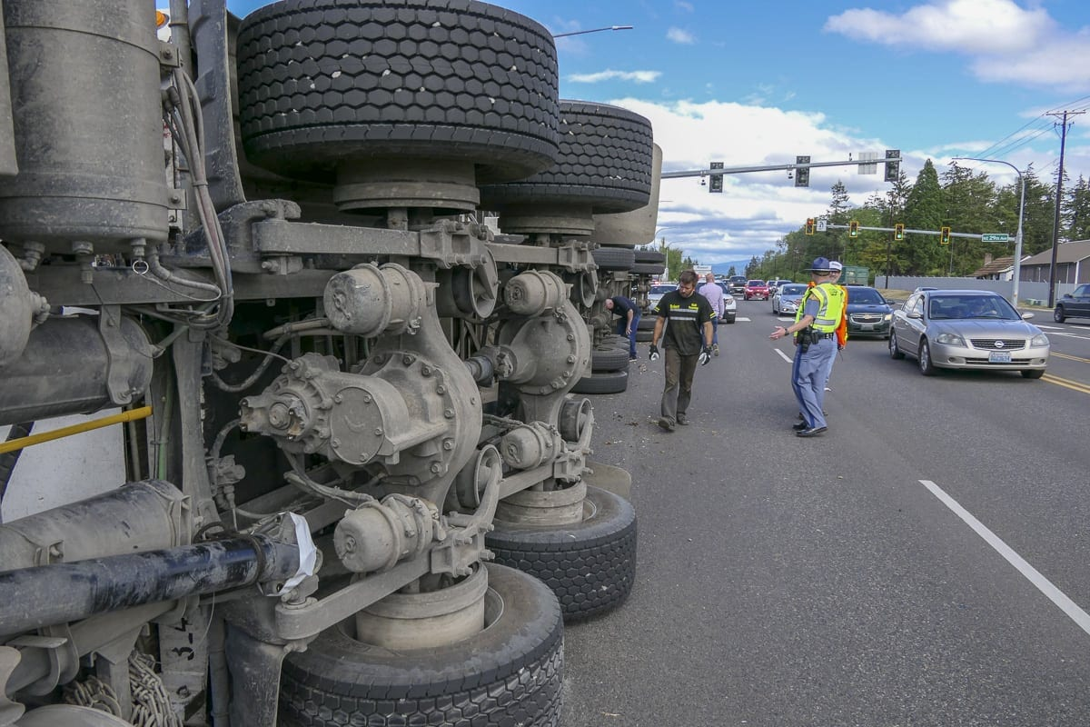 An overturned truck spilled thousands of chickens along SR-502 Westbound in Dollars Corner on Monday. Photo by Chris Brown