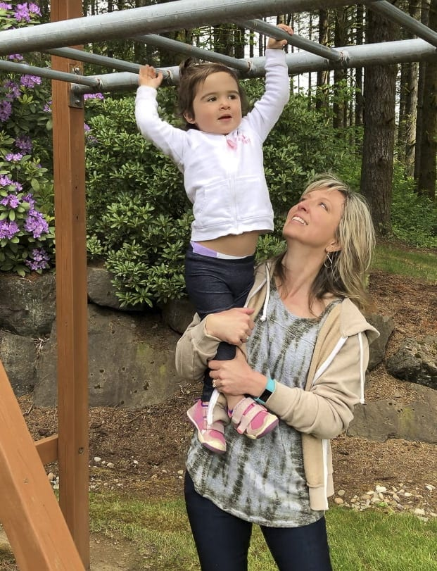 Nanny Heidi Wetzler enjoys the opportunity to help one of the children she cares for experience new heights. Photo courtesy of Anne Case