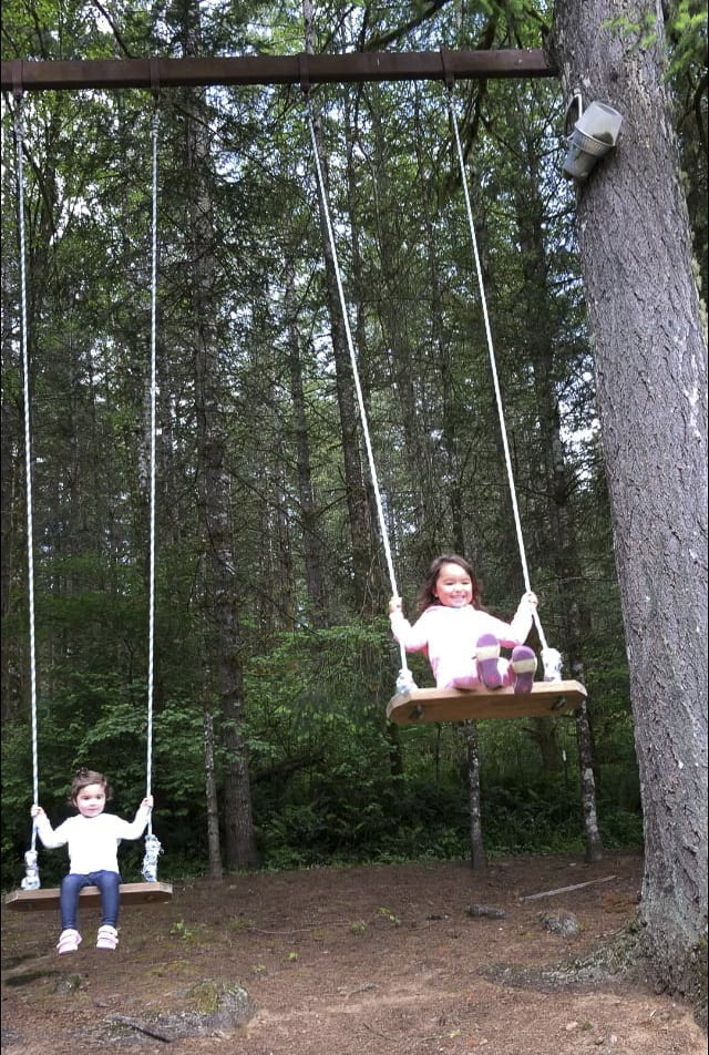 "These two happy children enjoy a swing during a recent trip to ""the castle in the woods.'' Photo by Heidi Wetzler"