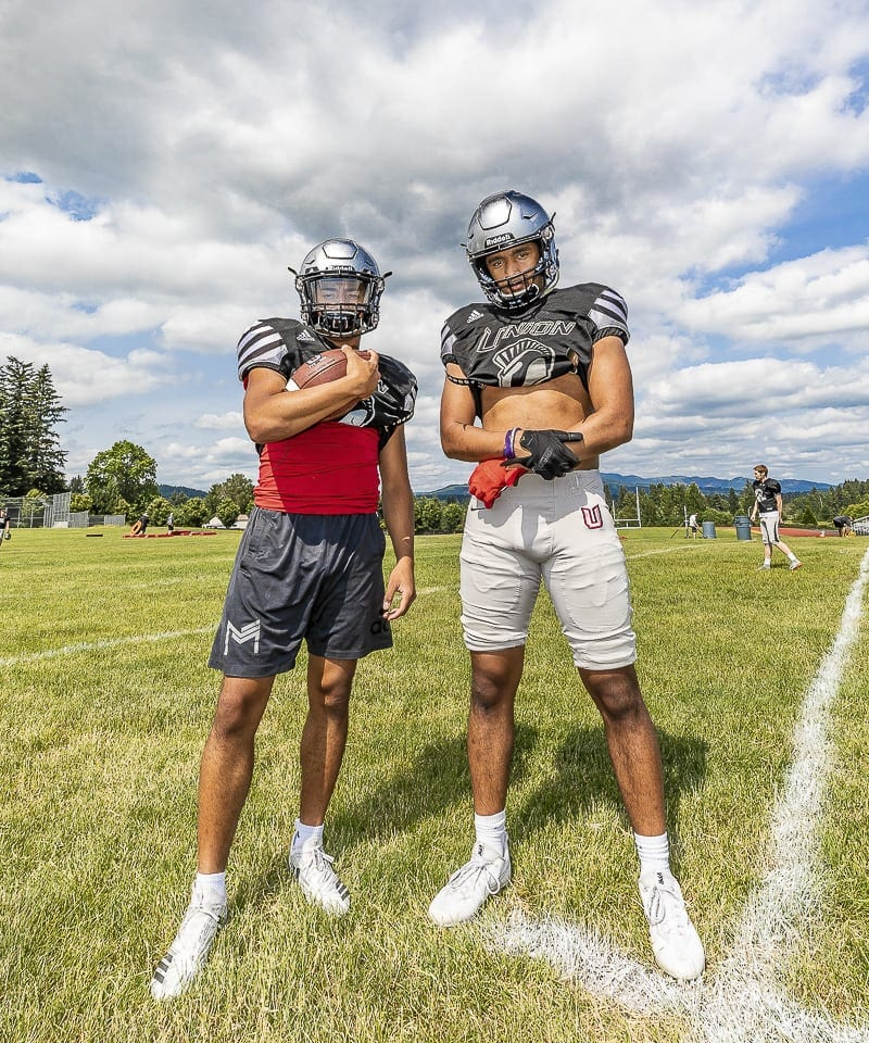 Lincoln Victor (left) and Darien Chase helped Union win the Class 4A Greater St. Helens League title last fall. Now as seniors, they hope Union will go on a longer playoff run in 2018. They also are dealing with the recruiting game. Both have offers from Division I college programs. Photo by Mike Schultz