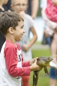 The 51st annual Frog Jumping Contest will take place Saturday at 1:30 p.m. The event is a favorite among children each year at Woodland's Planters Days. Photo by Mike Schultz