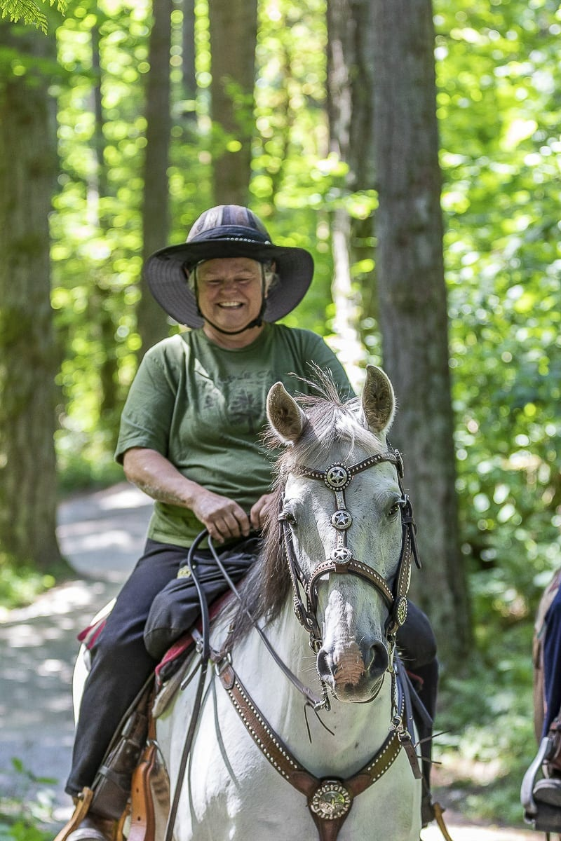 Anita Will, founder of the Whipple Creek Restoration Committee, rides her horse Nifty through the park. Photo by Mike Schultz
