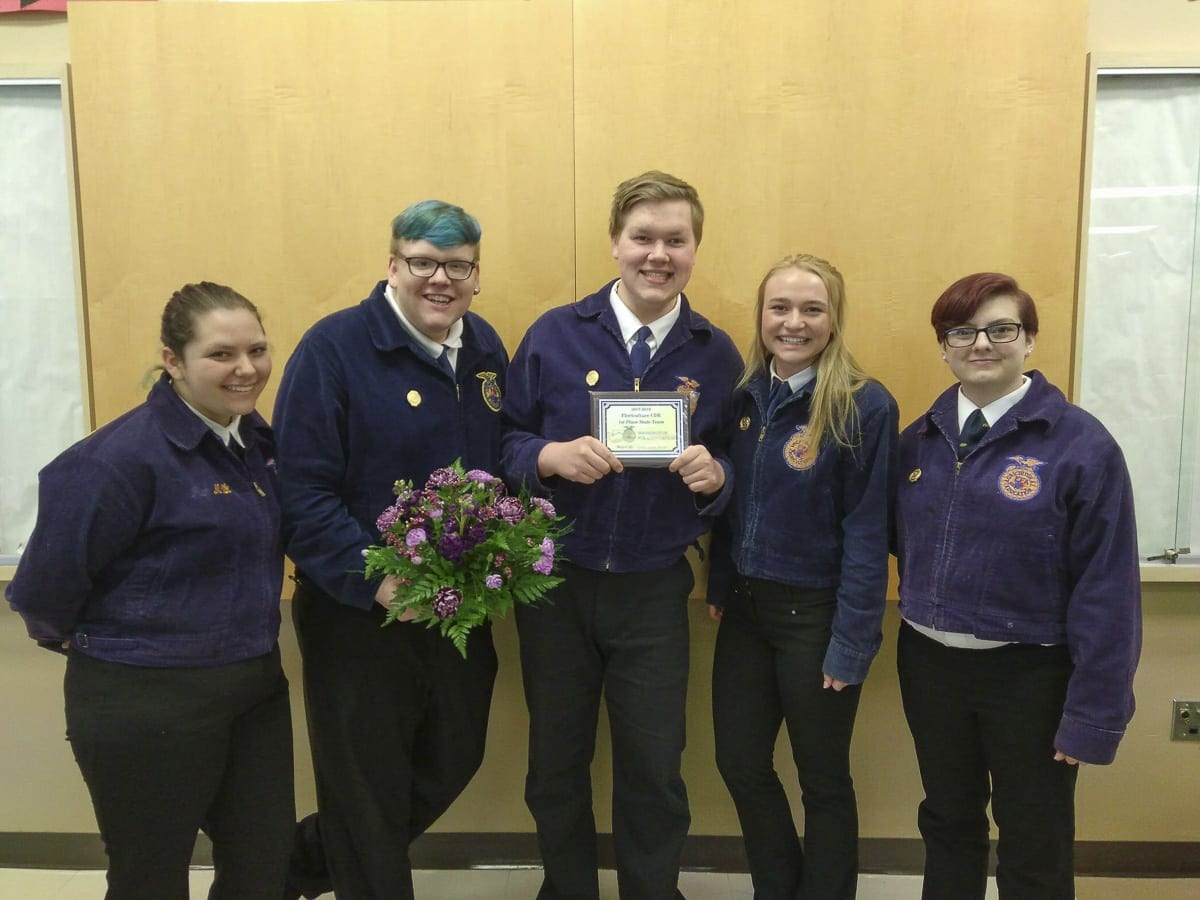 Cooper Kaml (pictured center) along with the Woodland High Future Farmers of America team, won the state championship at the Washington State FFA Convention in March, and will be heading to Indianapolis, IN, this October to compete in nationals. Photo courtesy of Cooper Kaml