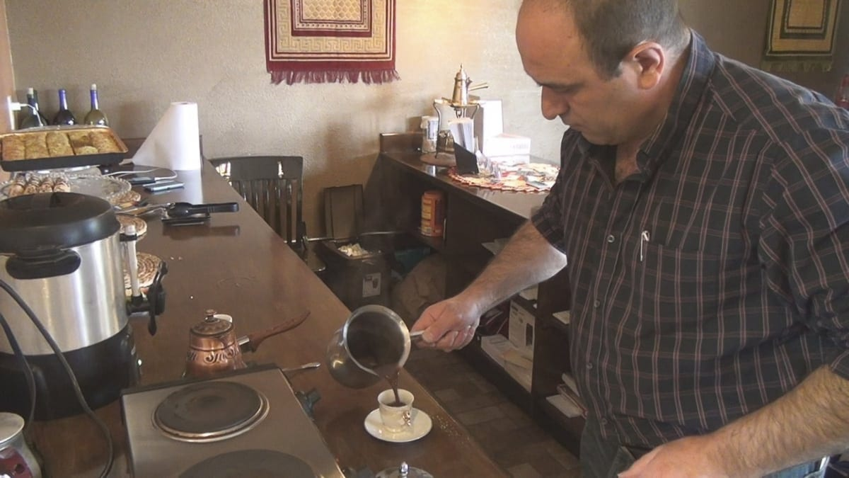 Jaber Sukaria, manager and part owner of The Pita House, prepares a cup of Turkish coffee. Sukaria and his staff pride themselves on treating every customer as a guest in their own home. Photo by Michael McCormic Jr.
