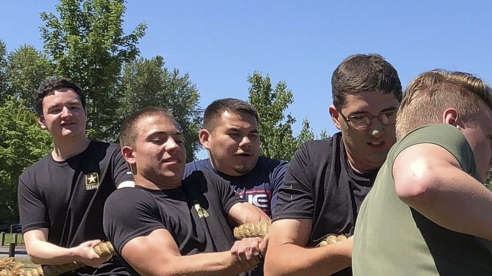 Upon graduating from Ridgefield High School, Joseph Campbell (pictured center) plans to enlist in the Army and train to be a medic. Photo courtesy of Joseph Campbell