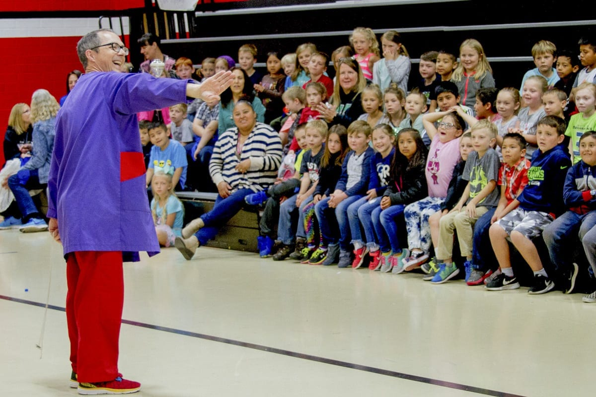 Thomas Thomas, a professional circus performer and juggler, used tops to teach Woodland Primary School students about rotational mass. Photo courtesy of the Woodland School District