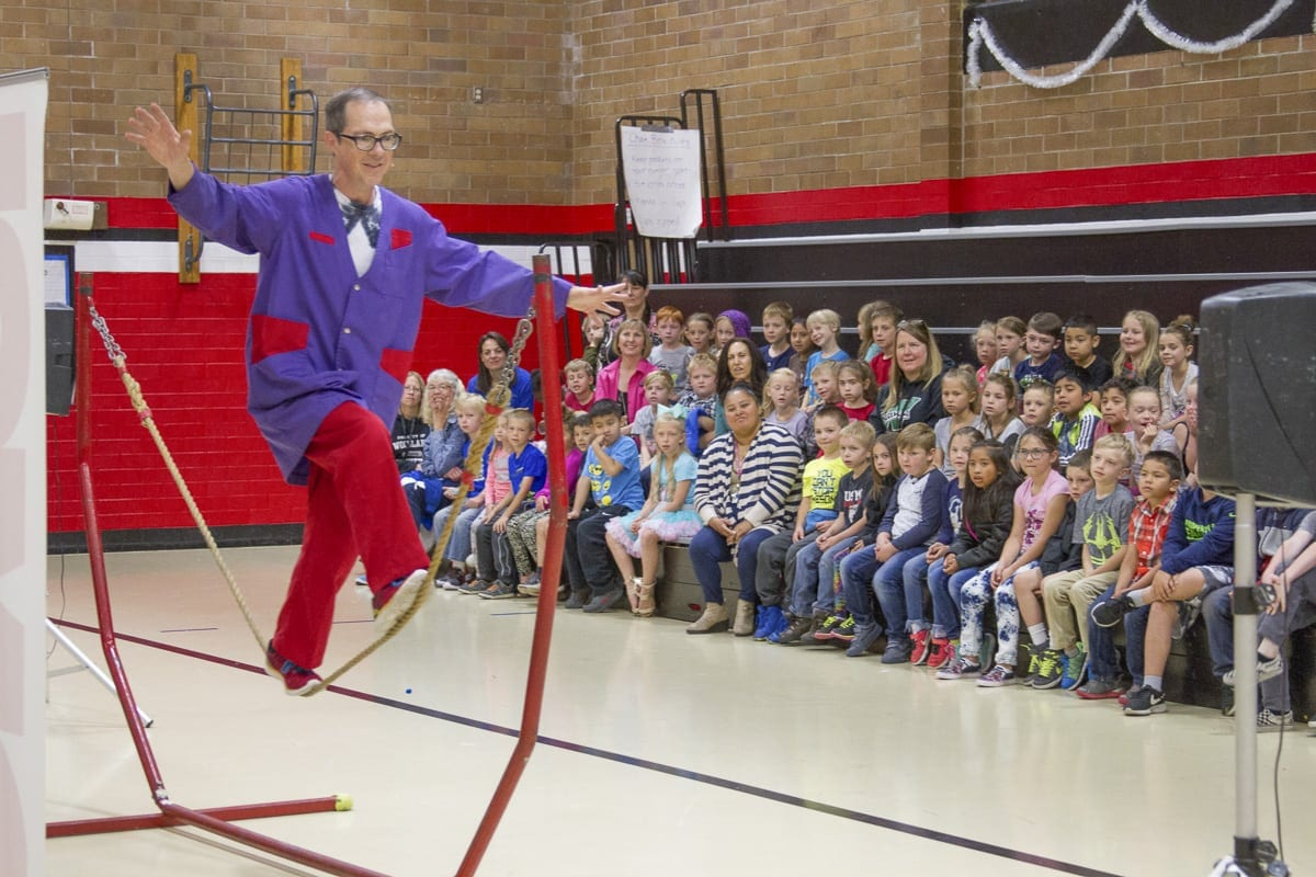 Thomas Thomas closed his performance at Woodland Primary School with a finale, juggling multiple items while balancing on a tightrope. Photo courtesy of the Woodland School District