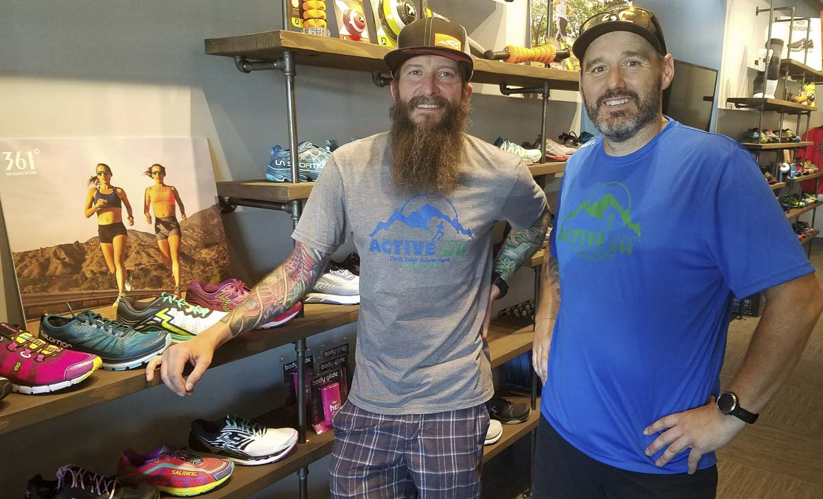 Ben Christly, left, and Ron Homer are ready for the opening of Active NW, a store focusing on athletic shoes and apparel. Christy, the owner, and Homer, the manager, are hoping the central Vancouver neighborhood continues to support locally owned businesses. Christly also owns Ben's Bottle Shop in The Mill shopping center. Photo by Paul Valencia