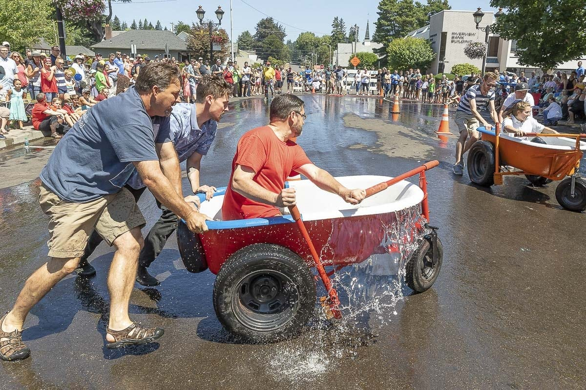 Ken Navidi, Jacob Schulstad and Craig Schulstad — of the Light Brigade — navigate a turn during a heat of the bathtub races at the annual Camas Days celebration Saturday. Photo by Mike Schultz