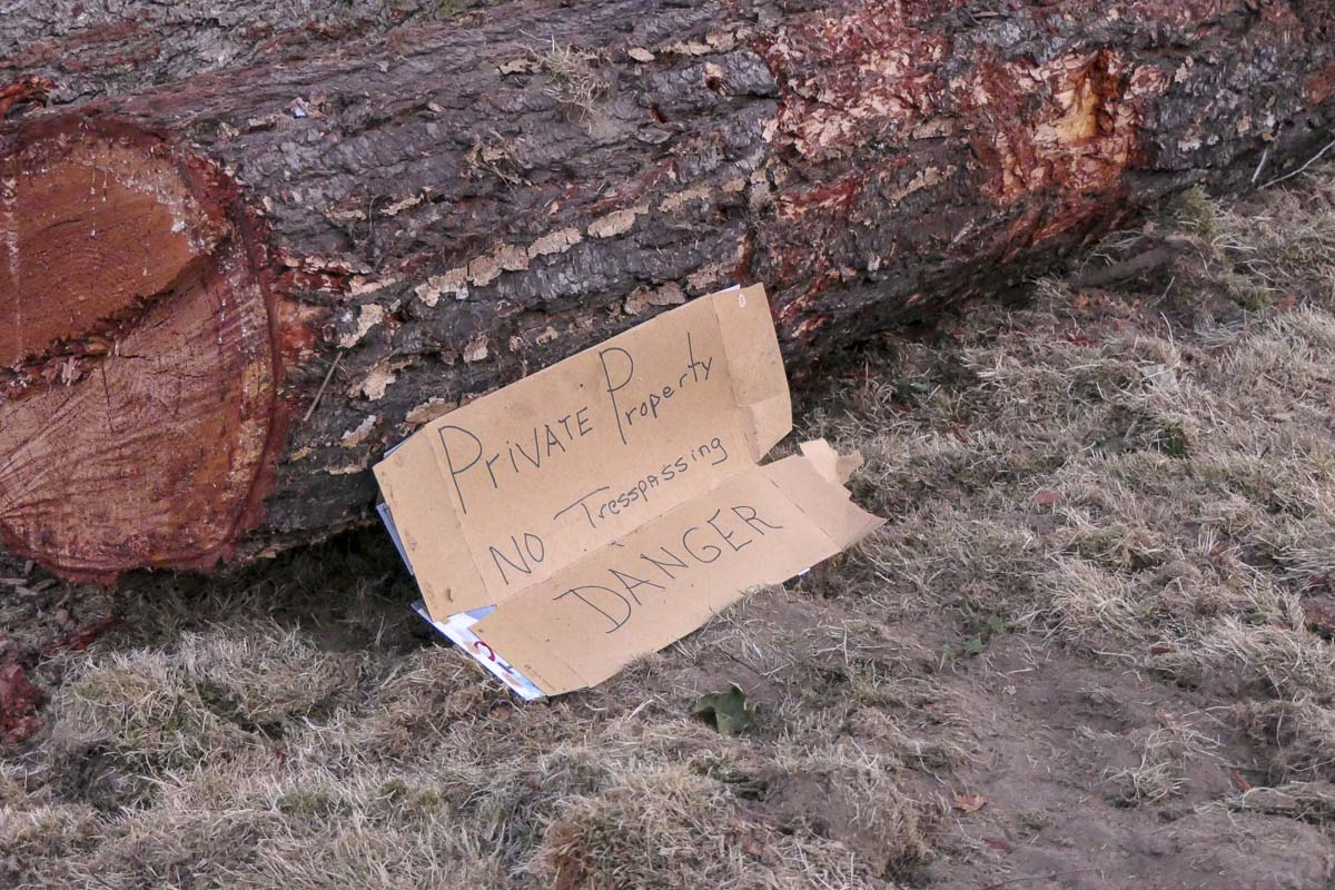 Signs at a clear-cutting operation in the city of Camas warn people to stay off the property. Many people have been upset about the project, which cut down several trees that were nearly 150 years old. Photo by Chris Brown