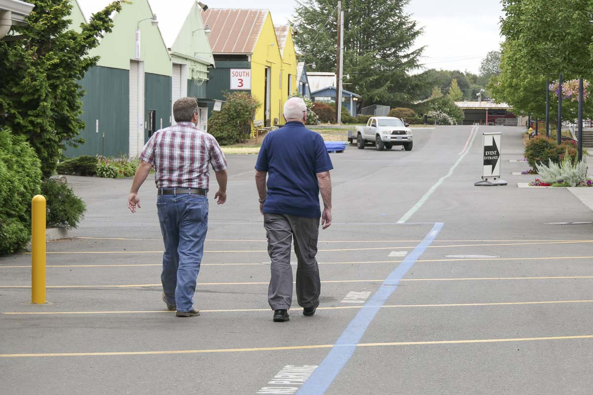 Outgoing Clark County Fair Director John Morrison (right) walks the grounds with his replacement, Mickey Webb. Photo by Chris Brown