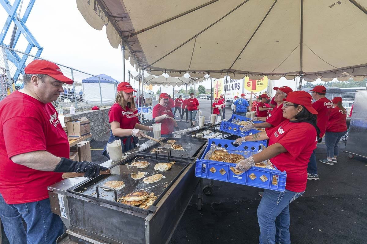 80 volunteers from Fred Meyer prepare to feed around 10,000 people during the annual free pancake breakfast to kick off the Clark County Fair. Photo by Mike Schultz