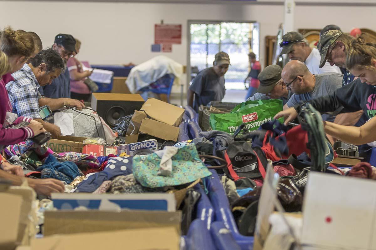 Many people make or supplement their living with inexpensive discards at the Goodwill Outlet Store. Photo by Mike Schultz