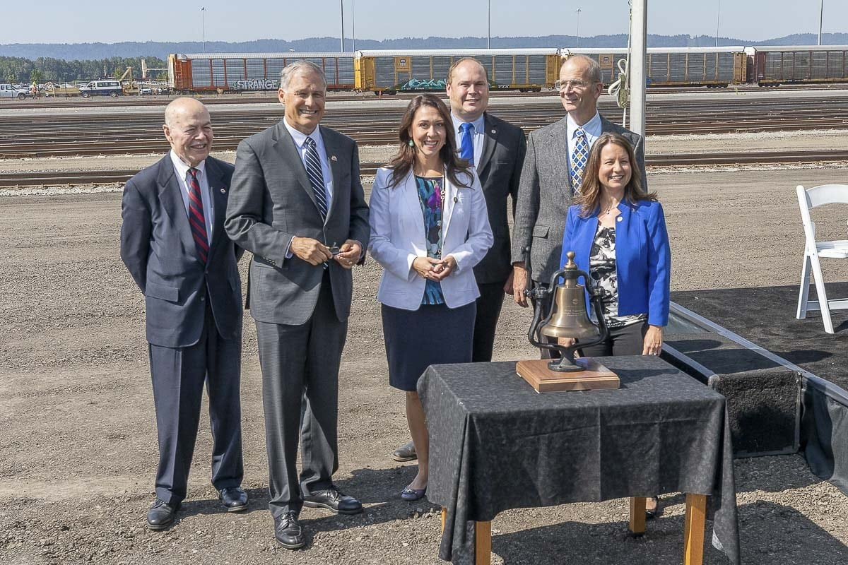 Washington Governor Jay Inslee and Congresswoman Jaime Herrera Beutler pose with Port of Vancouver officials at the grand opening of the West Vancouver Freight Access project. Photo by Mike Schultz