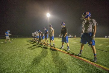 Ridgefield football uses midnight magic to open season