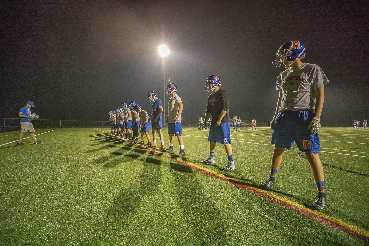The Ridgefield Spudders started the football season as soon as they could, holding a Midnight Madness style practice Wednesday early, early morning. Wednesday is the first official day of high school football practice in Washington. Photo by Mike Schultz