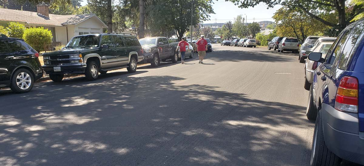 Evergreen teachers walk to a picket line near Burton Elementary on Wednesday. Cars line the road after the district shut down the school parking lot. Photo by Paul Valencia