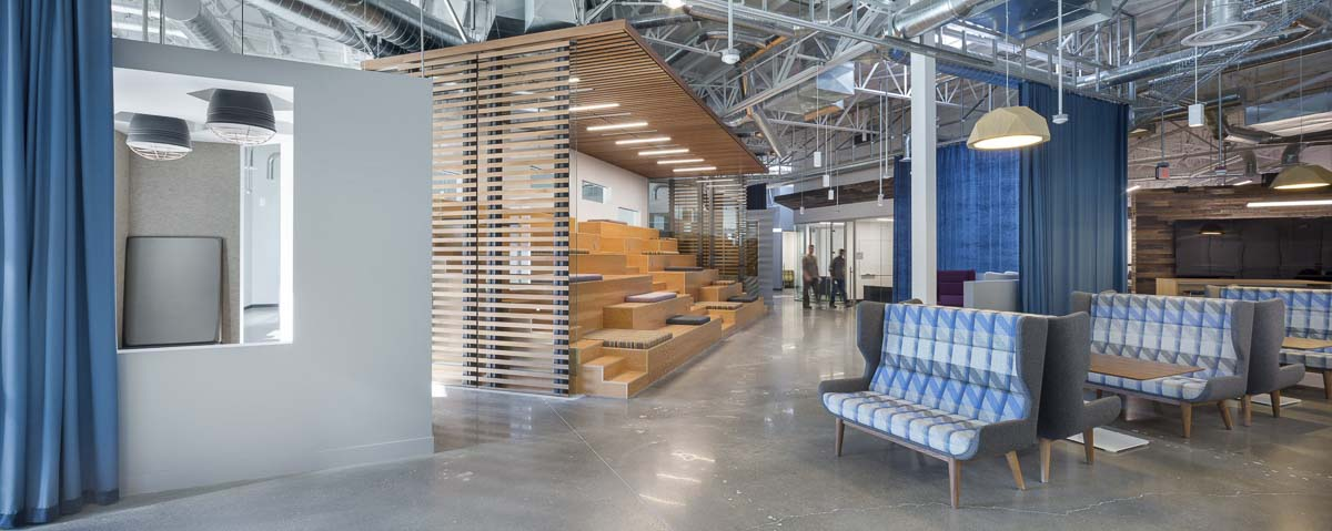 "The new HP office building, opened in 2016, focuses on providing a comfortable, modern workspace for employees. The office ""bleachers,"" pictured above, is where workers gather for larger-scale meetings and conferences. Photo courtesy of HP Vancouver."