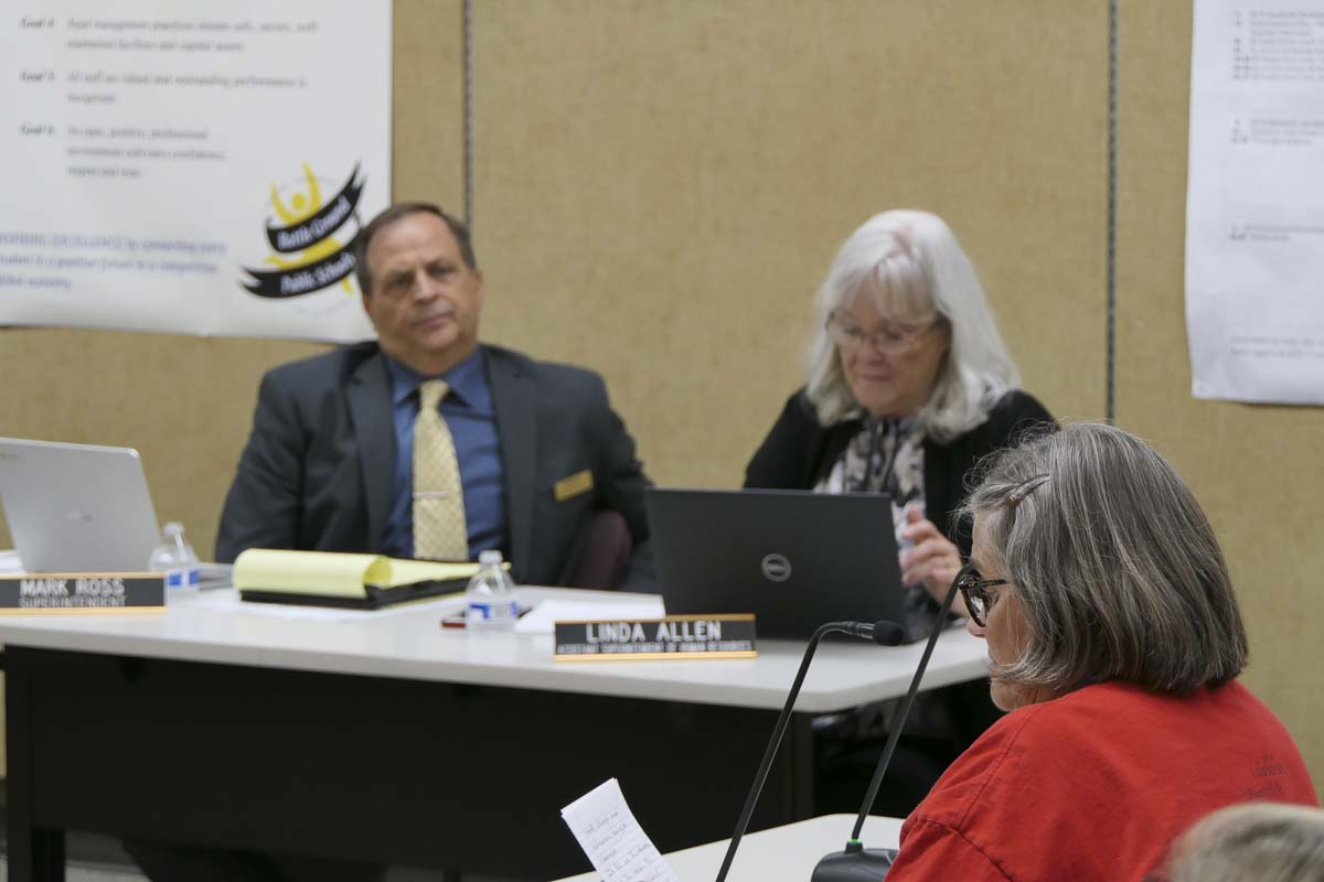 Battle Ground Superintendent Mark Ross listens as BGEA President Linda Peterson makes remarks during Monday's school board meeting. Photo by Chris Brown