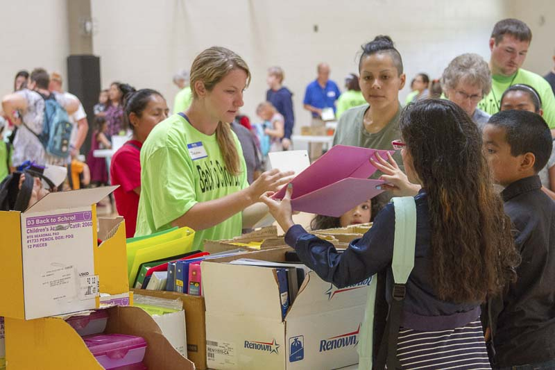 Woodland Public Schools staff and 175 volunteers gave out free backpacks filled with school supplies at this year's Back to School Bash. Photo courtesy of Woodland Public Schools