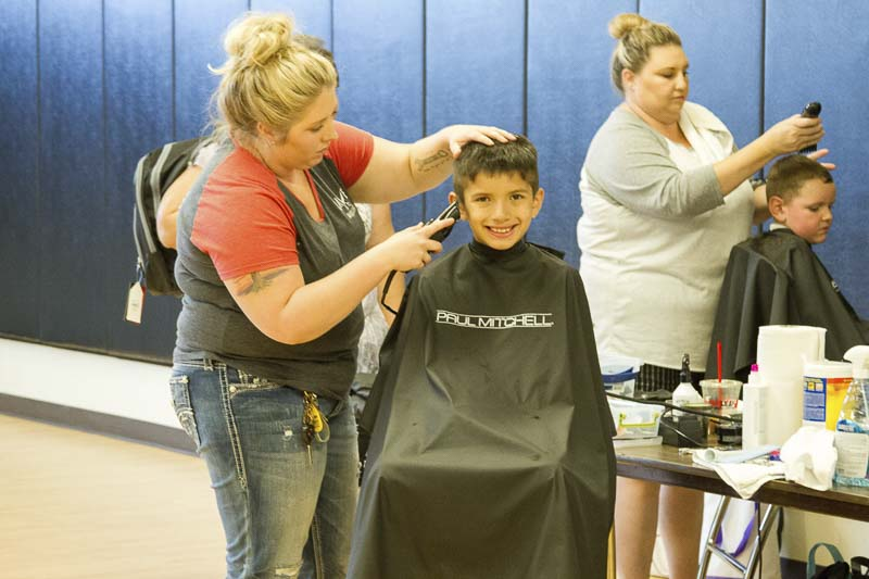 Attendees at the Woodland Back to School Bash could also receive free haircuts and access other services at the event. Photo courtesy of Woodland Public Schools