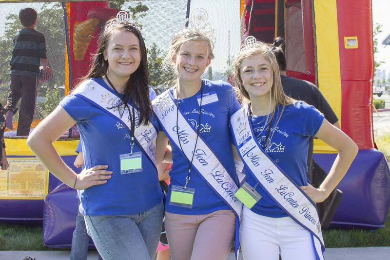 The Miss Teen La Center Court volunteered at the Woodland Back to School Bash (pictured from left: Danielle Gawronski, Sara Baldwin, and Keira Crocker). Photo courtesy of Woodland Public Schools