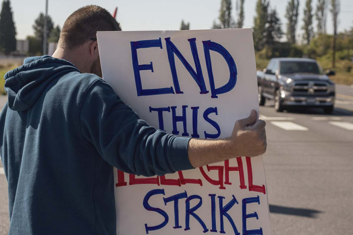 Battle Ground resident Ben Culley protests the ongoing teacher strike. Photo by Jacob Granneman