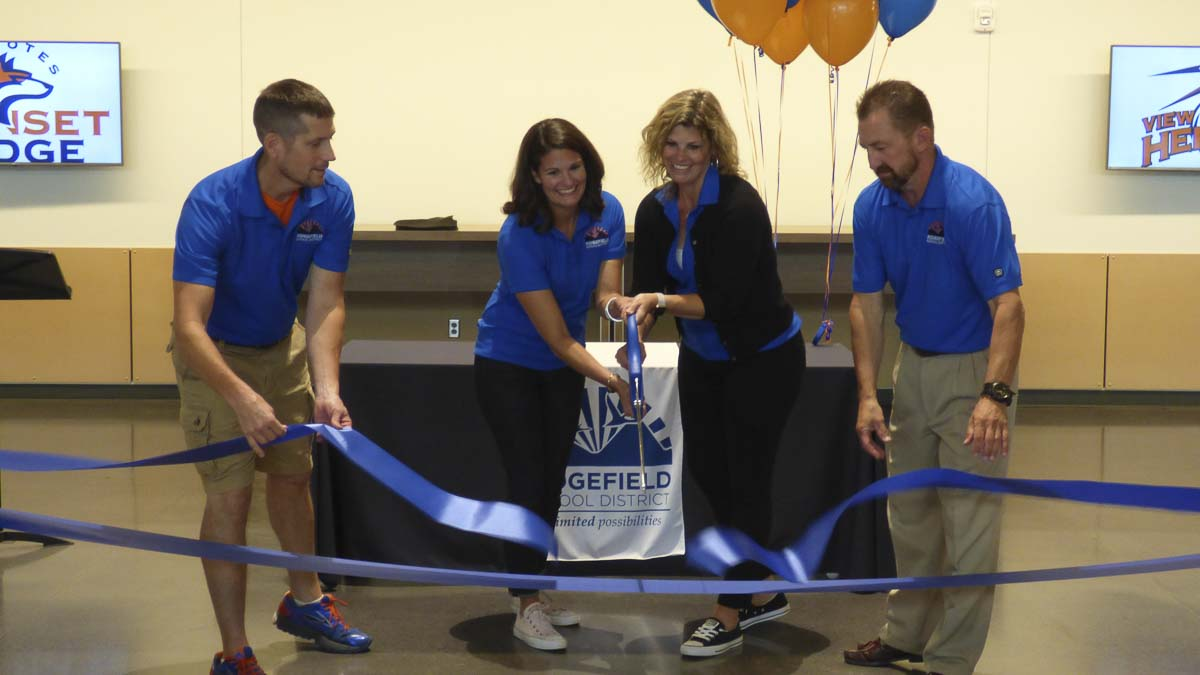 Superintendent Nathan McCann (left) looks on as Ridgefield School Board members Emily Enquist, Becky Greenwald and Scott Gullickson do the ribbon-cutting honors to officially open the new campus for Grades 5-8 in Ridgefield. Photo courtesy of Ridgefield School District