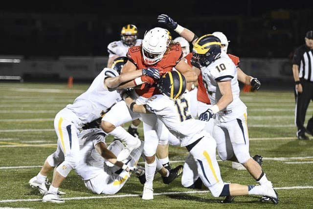 Camas receiver Luc Sturbelle is so strong, it takes half the Bellevue defense to take him down. Sturbelle had eight catches for 143 yards and three touchdowns in Week 4. Photo by Kris Cavin