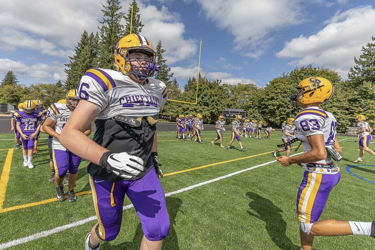The Columbia River Chieftains, shown here practicing on their new field, get to play a game for the first time on the new field on campus. They host rival Skyview on Friday. Photo by Mike Schultz