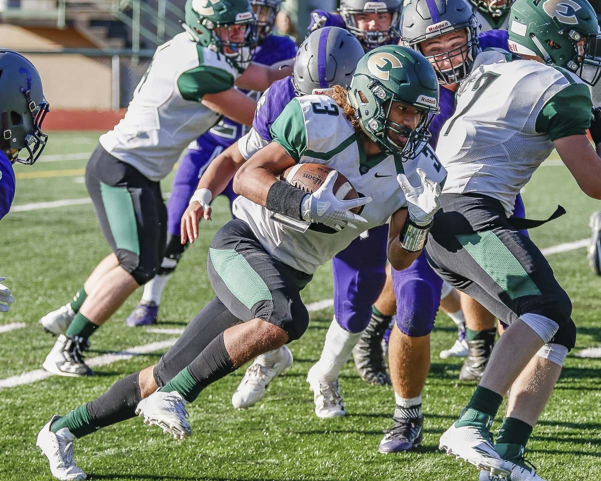 Evergreen's Eli Vaa-leiataua, shown here in Week 1, had more than 100 yards rushing for the second week in a row. This week, though, the Plainsmen got the victory to go with those yards. Photo by Mike Schultz
