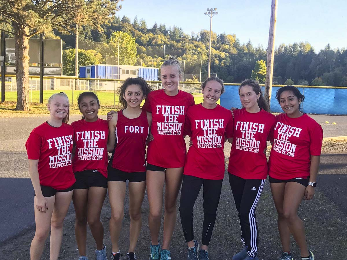 The Fort Vancouver girls cross country team won the program's first league title Tuesday. These champions will get to hang a banner: (From left to right) Shelby Willett, Emma Cortez, Jessica Vicente, Anna Harrison, Emily Phelps, Khonnie Ecklund, and Dhamar Campos. Photo by Owen Frasier.