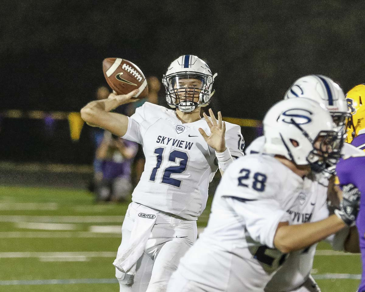 Skyview quarterback Yaroslav Duvalko (12) registered his first win as a starter Friday at Columbia River. He finished with 222 yards passing and four touchdowns. Photo by Mike Schultz