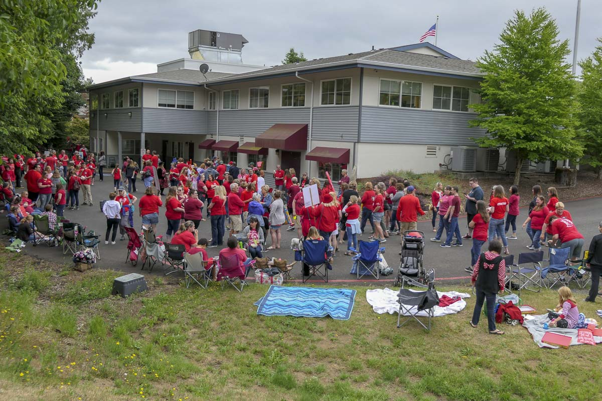 Battle Ground teachers rally outside school district headquarters in Brush Prairie. Photo by Chris Brown