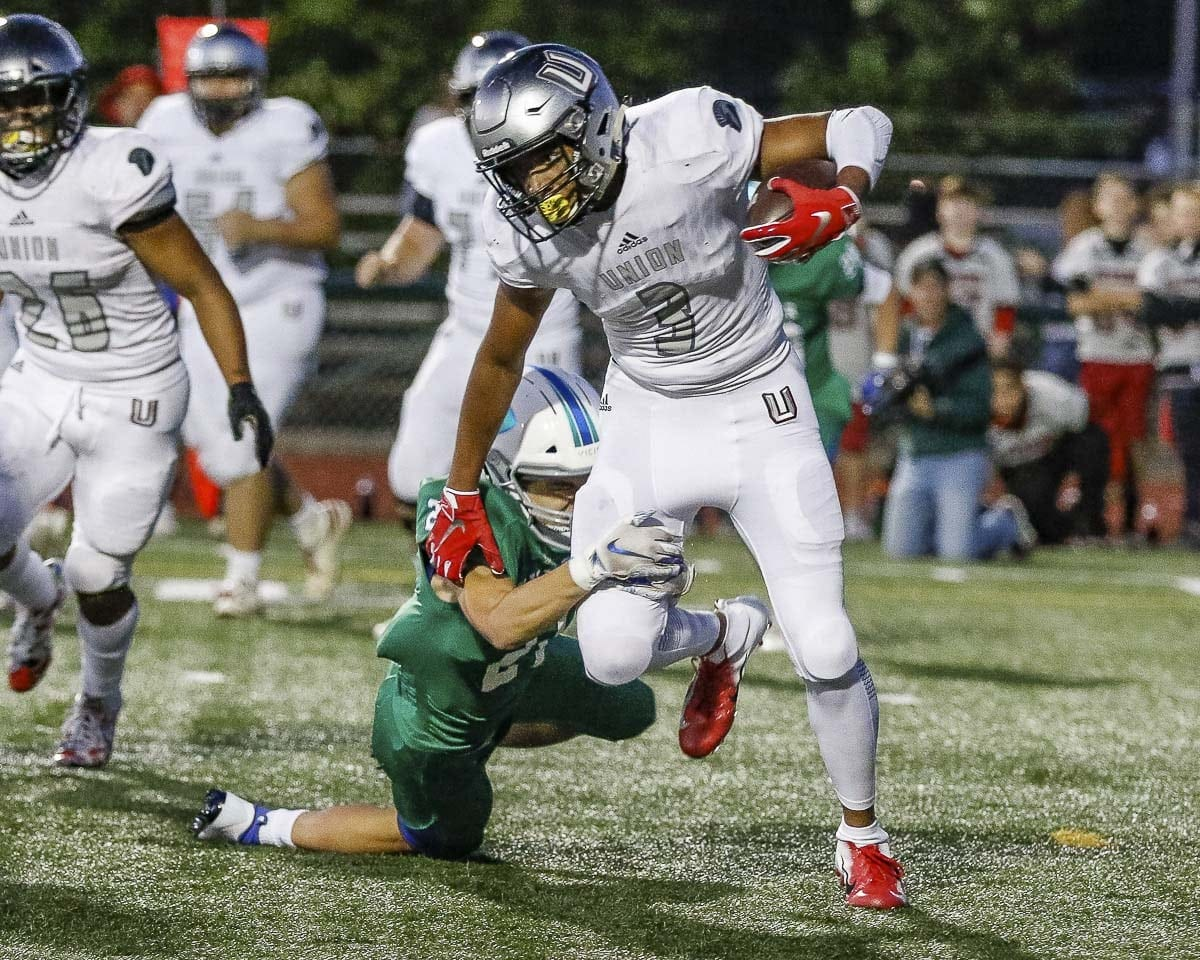 Union's Darien Chase (3), shown here in the Titans' win over Mountain View in Week 1, returned a kickoff for a touchdown with 29 seconds to go in the game to give Union a victory in El Cerrito, Calif. Friday night. Photo by Mike Schultz