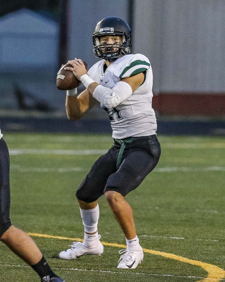 Woodland quarterback Tyler Flanagan has thrown for more than 700 yards and rushed for more than 700 yards through four weeks of the season. Photo by Mike Schultz